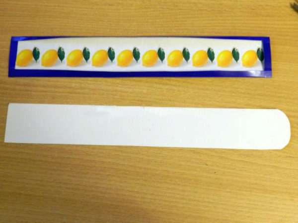 Полоска с изображением лимонов и полоска из белого картона