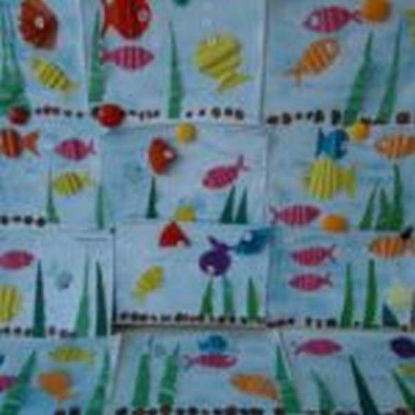 Рыбки из бумаги, сложенной гармошкой