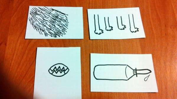 На листах бумаги изображены части тела животного и бутылочка с молоком